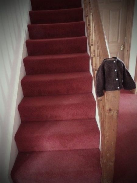 brown cardigan stairs